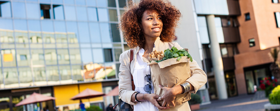 young woman carrying groceries