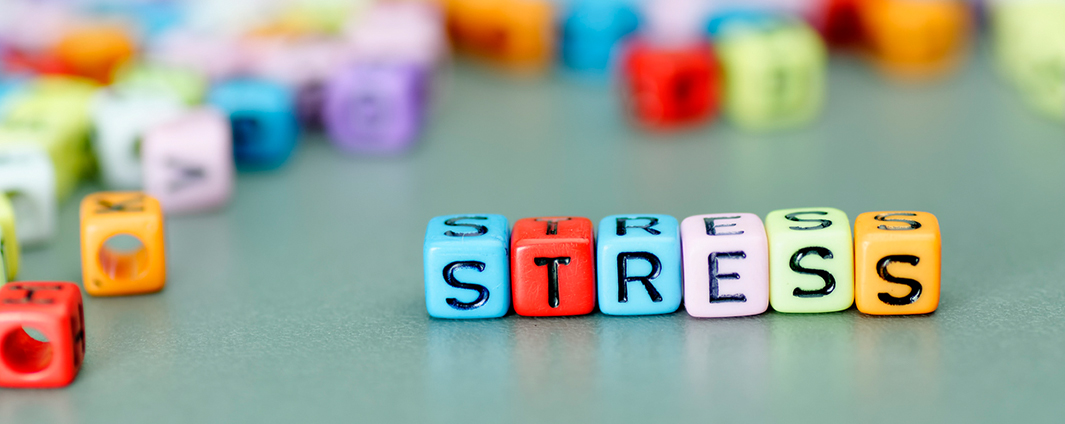 Square colour beads spelling stress