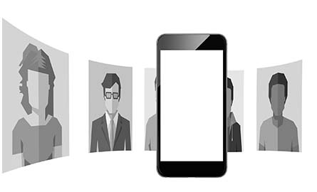 A silhouette of many faces around a cell phone